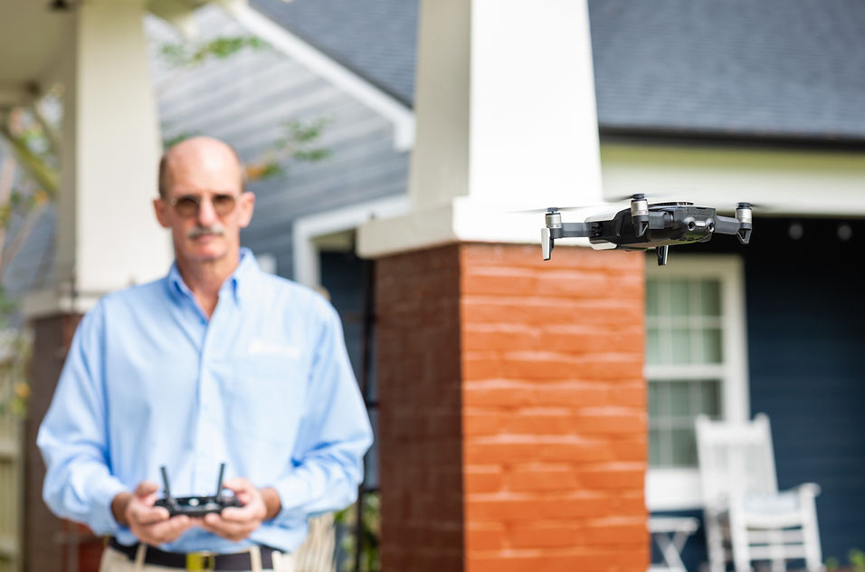 Inspector Bill Horner flying an aerial drone during a home inspection