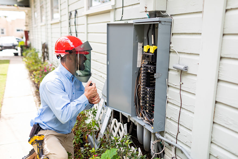 Alex checking an electrical system while preforming home inspection services
